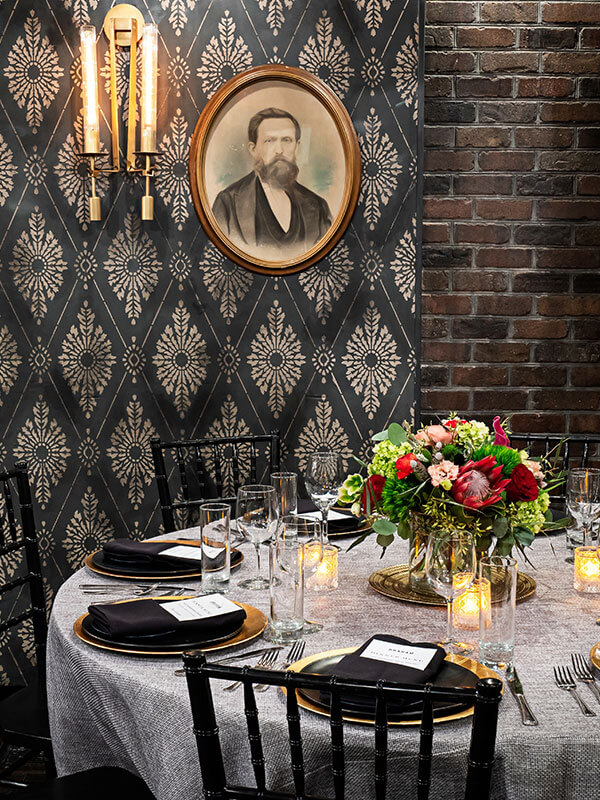A dining table set for an event.